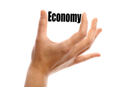 economic development: Horizontal shot of a hand holding the word Economy between two fingers, isolated on white.