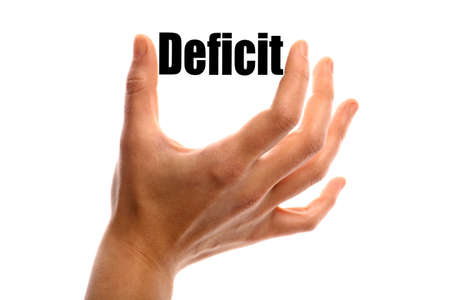 deficit: Horizontal shot of a hand holding the word Deficit between two fingers, isolated on white.