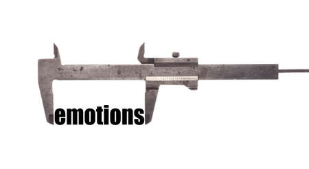humanism: Color horizontal shot of a caliper measuring the word emotions. Stock Photo