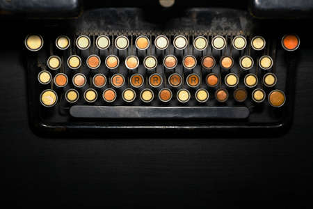 Color detail of the keyboard of an old typewriter. All the keys are empty except for three that read ERROR. photo