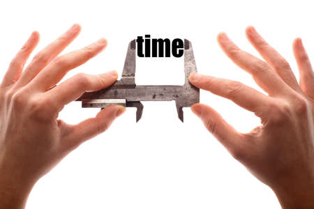 caliper: Color horizontal shot of two hands holding a caliper and measuring the word time. Stock Photo