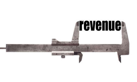 profitability: Color horizontal shot of a caliper and measuring the word revenue.