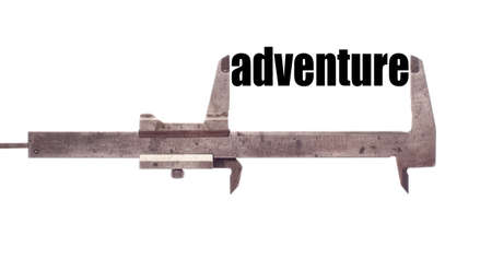 wanderlust: Color horizontal shot of a caliper and measuring the word adventure.