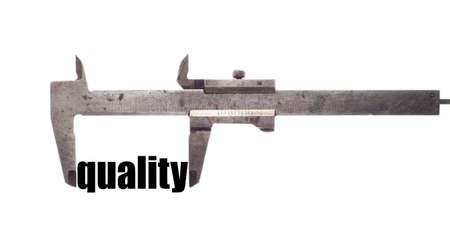 quality service: Color horizontal shot of a caliper and measuring the word quality. Stock Photo