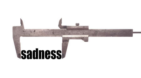 sadness: Color horizontal shot of a caliper and measuring the word sadness.