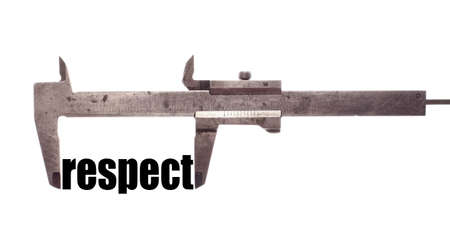 decency: Color horizontal shot of a caliper and measuring the word respect.
