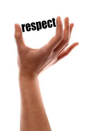 decency: Color vertical shot of a of a hand squeezing the word respect. Stock Photo