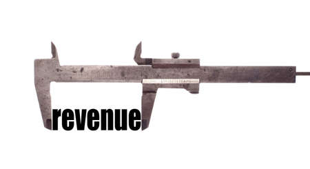business symbols metaphors: Color horizontal shot of a caliper and measuring the word revenue.