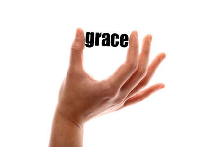pain scale: Color horizontal shot of a of a hand holding the word grace.