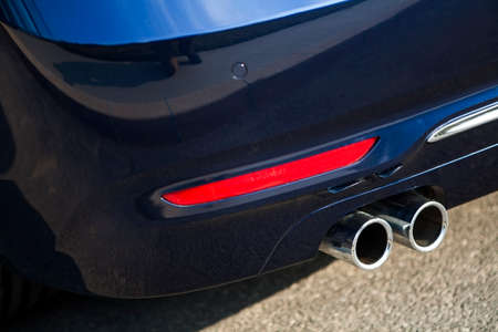 carbon emission: Detail of the double exhaust of a car