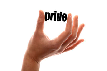 exact: Color horizontal shot of a of a hand squeezing the word pride.