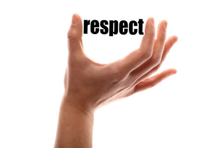 decency: Color horizontal shot of a of a hand squeezing the word respect. Stock Photo
