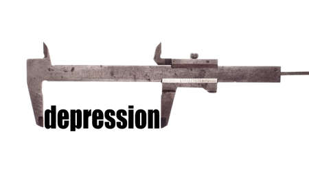 pain scale: Color horizontal shot of a caliper and measuring the word depression.