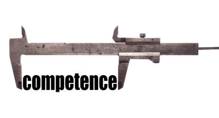 competence: Color horizontal shot of a caliper and measuring the word competence.