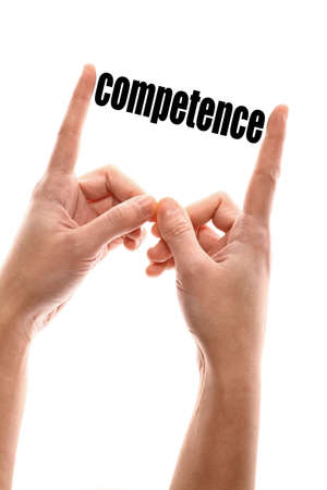 Color vertical shot of two hands squeezing the word competence.