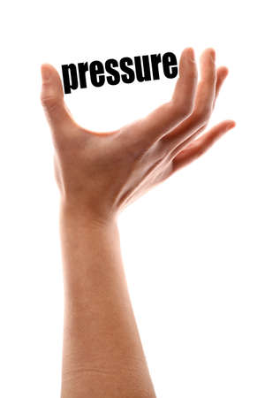 atmospheric: Color vertical shot of a of a hand holding the word pressure. Stock Photo