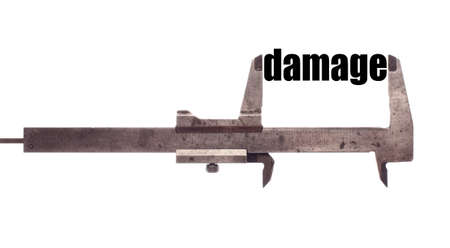 damage: Color horizontal shot of a caliper and measuring the word damage.