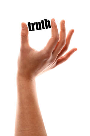 exact: Color vertical shot of a of a hand squeezing the word truth. Stock Photo