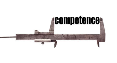 suitability: Color horizontal shot of a caliper and measuring the word competence.