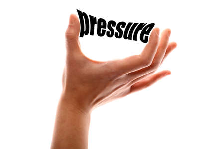 atmospheric pressure: Color horizontal shot of a of a hand suqeezing the word pressure. Stock Photo