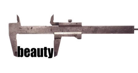 exact: Color horizontal shot of a caliper and measuring the word beauty.