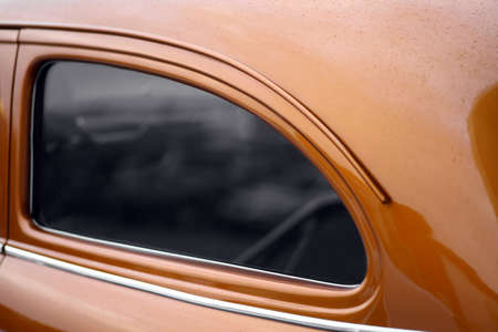 windows and doors: Color picture of a vintage cars back side window. Stock Photo