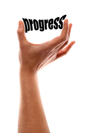 growth enhancement: Color vertical shot of a of a hand squeezing the word progress.
