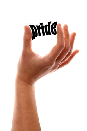 dignity: Color vertical shot of a of a hand squeezing the word pride.