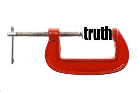 untrue: The word truth is compressed with a vice. Stock Photo