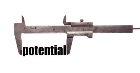 potential: Color horizontal shot of a caliper and measuring the word potential. Stock Photo