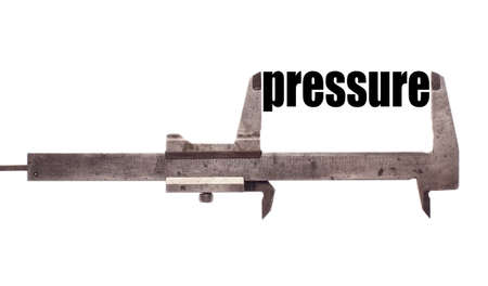 atmospheric pressure: Color horizontal shot of a caliper and measuring the word pressure. Stock Photo