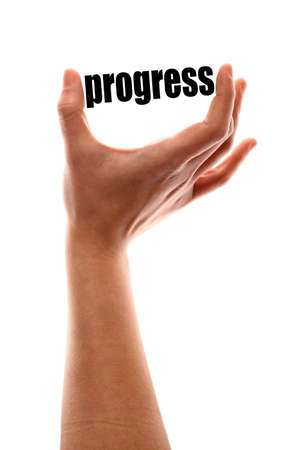 creative potential: Color vertical shot of a of a hand squeezing the word progress.
