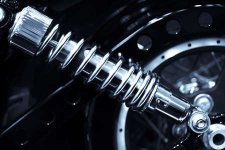 Color shot of a motorcycle shock absorber. Stock Photo