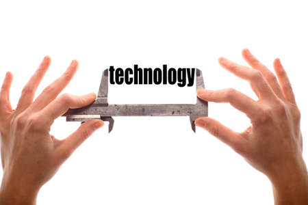 exact: Color horizontal shot of two hands holding a caliper and measuring the word technology.