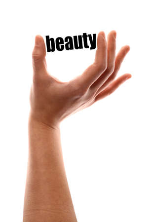 exact: Color vertical shot of a of a hand squeezing the word beauty. Stock Photo