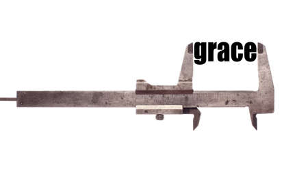 grace: Color horizontal shot of a caliper and measuring the word grace.