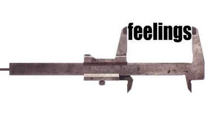 sensing: Color horizontal shot of a caliper and measuring the word feelings.