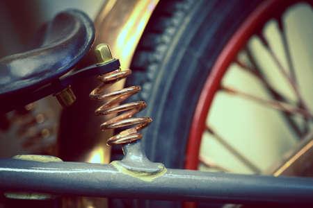 absorber: Color shot of a vintage motorcycle shock absorber.