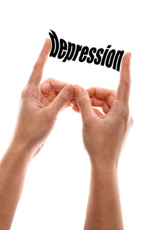 pain scale: Color vertical shot of a of a hand squeezing the word depression. Stock Photo