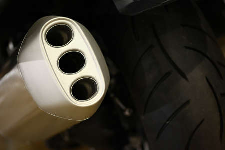 exhaust pipe: Color image of a motorcycle exhaust pipe.