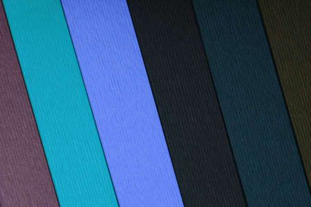 multiple image: Vertical image of a multiple colored paper stripes.