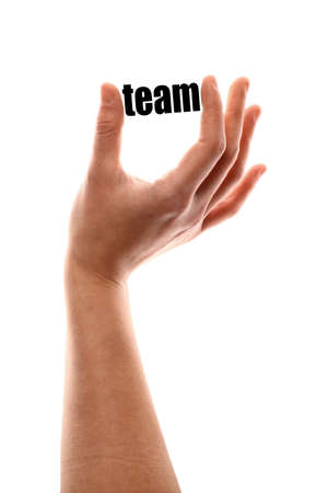 communication metaphor: Color vertical shot of a of a hand squeezing the word team.