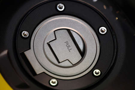 bike cover: Close-up shot of a motorcycle tank cap.