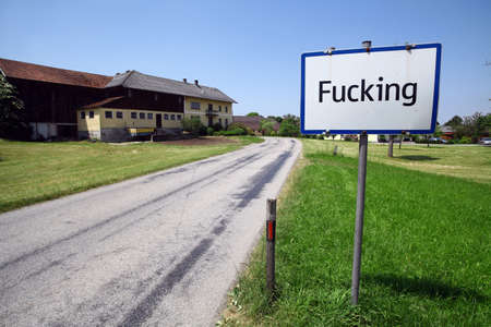 obscene: Color image of the traffic sign at the entrance in the village of Fucking, Austria. Stock Photo