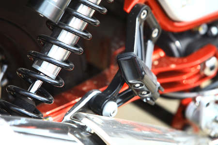 shock absorber: Color image of the rear shock absorber of a motorcycle.
