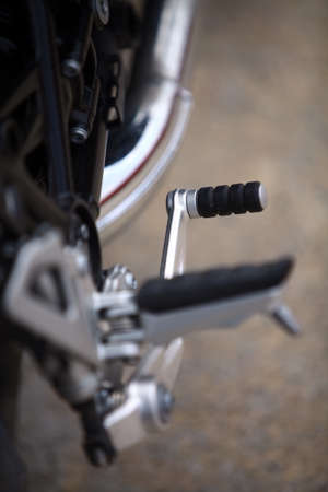 footrest: Color image of the gear shifter pedal of a motorcycle. Stock Photo