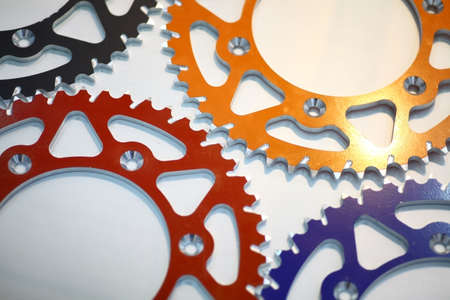 sprockets: Color image of various motorcycle sprockets.