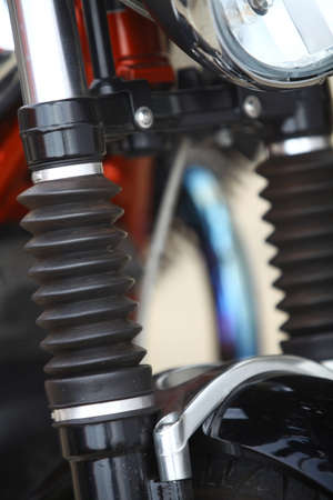 damper: Color image of the front shock absorber of a motorcycle.