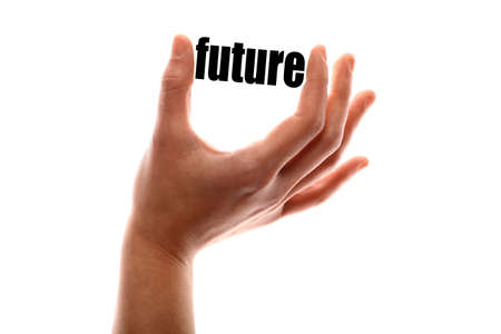 exact: Color horizontal shot of a hand squeezing the word future.