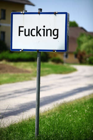 fucking: Color image of the traffic sign at the entrance in the village of Fucking, Austria. Actual shot, no added text.